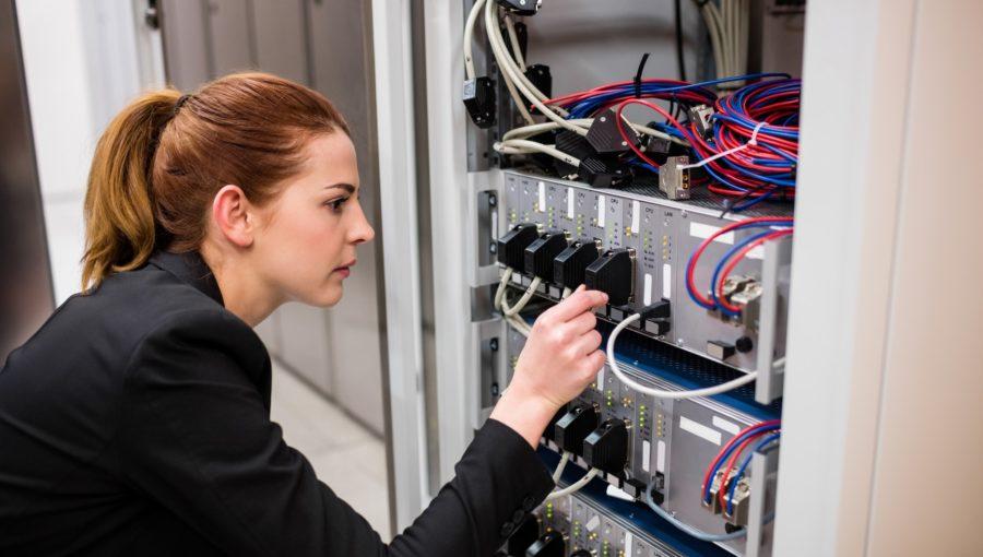 Technician examining server